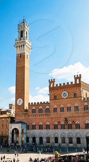 Torre del Mangia in piazza del Campo in Siena Italy. photo