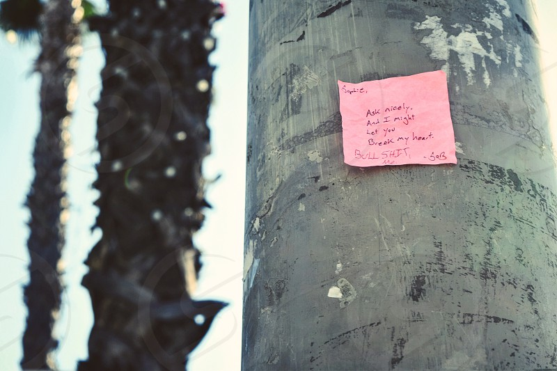 Handwritten note post-it hot pink Hollywood California pole street urban trendy love note photo
