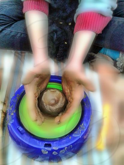 working on pottery wheel. photo