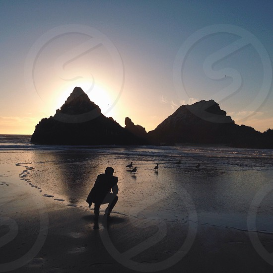 human and rocks silhouette  photo
