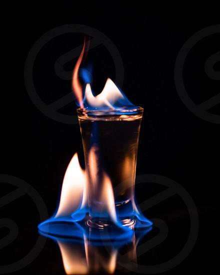 Fire flame hot shot alcohol minimal burn photo