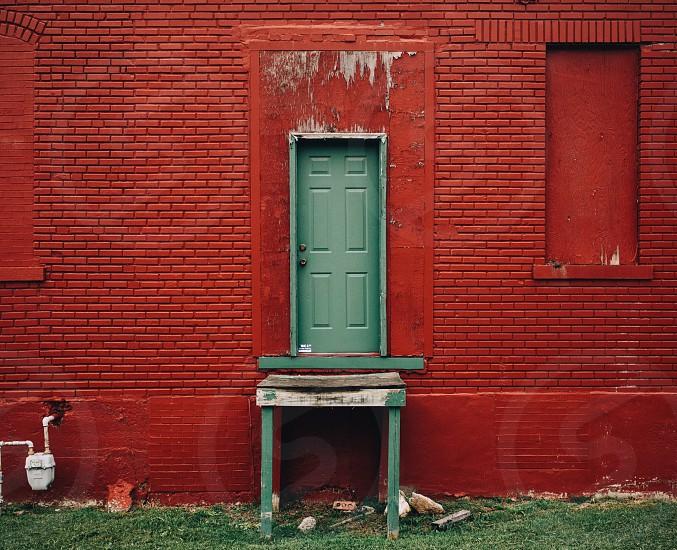 green door between red wall photo
