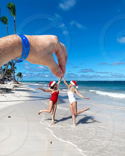 Girl sea sand beach woman hand funny summer ocean new year vacation travel  photo