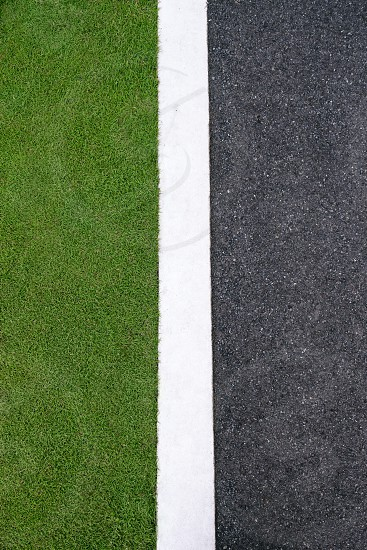 road; environment; field; grass; green; asphalt; abstract; backgrounds; boundary; concept; concepts; copy; copy space; copyspace; division; eco; ecology; edge; environmental; gray; hard; high angle; lane; line; no people; nobody; outdoor; outdoors; park; pavement; soft; space; street; surface; sustainability; urban; white photo