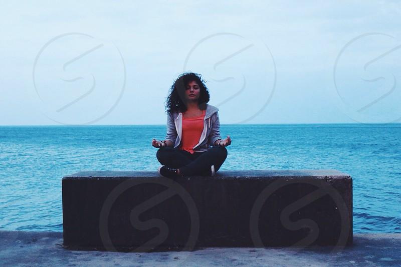 woman wearing grey jacket sitting photo