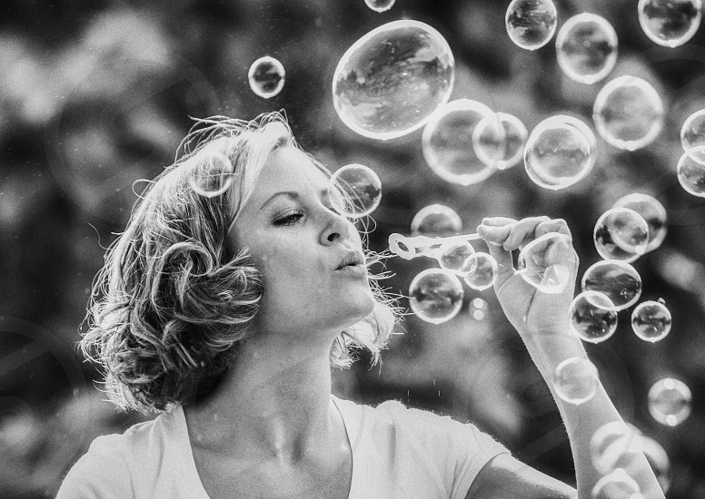 bubbles blowing creative daring black and white high iso bw pretty woman summer happy calm focused photo