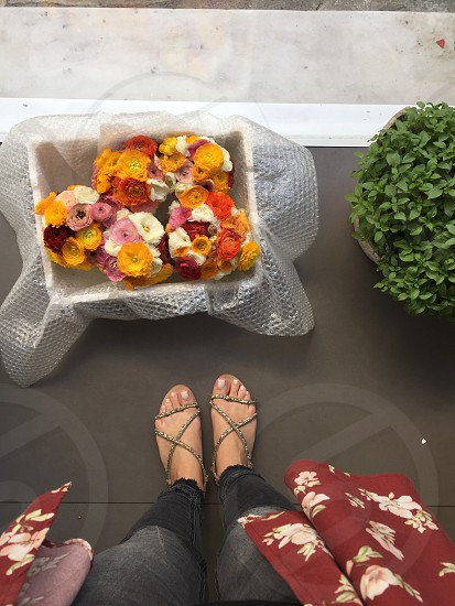 April spring May March flowers foot selfie summer sandals colorful flower bucket  photo