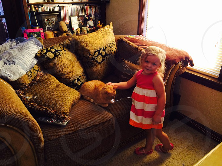 Lil Jessa visiting our cat..... photo