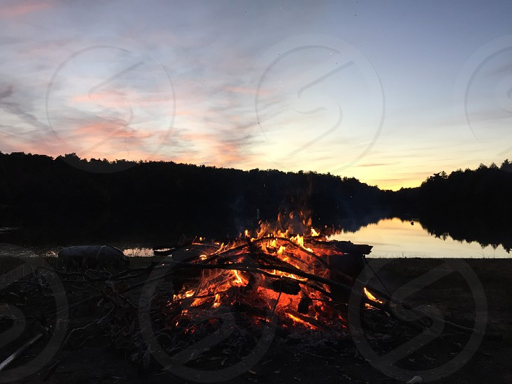 bonfire on seashore during sunset photo