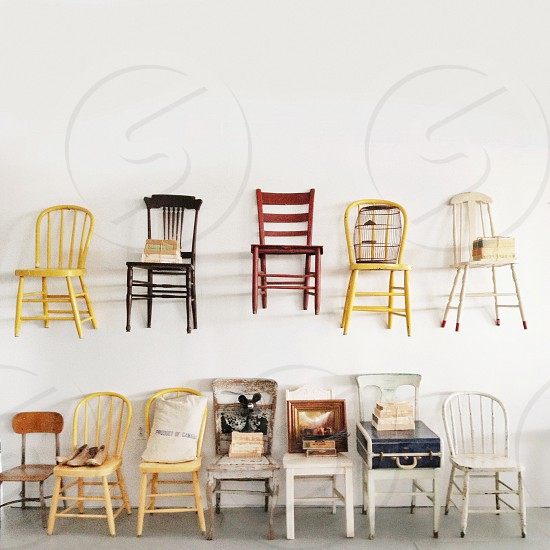 set of black white and yellow wooden chair photo