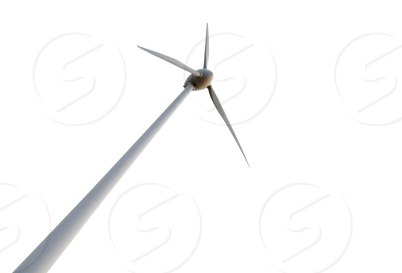 Low angle of the wind turbine isolated against white. photo