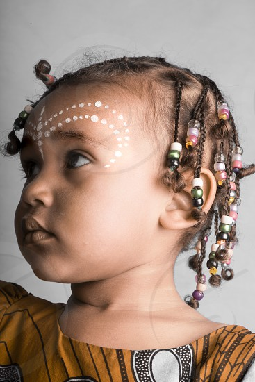 African American girl with a traditional face paint  in a hight quality studio photo  photo
