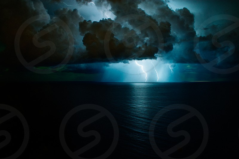 lightning strike sea night photo