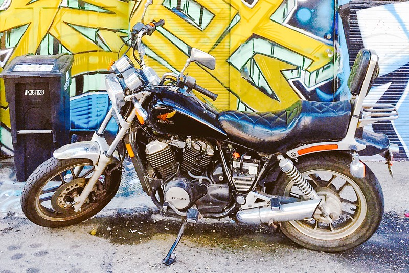 Motorcycle in front of graffiti wall photo