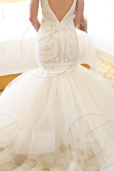 woman wearing white bodycon lace wedding dress photo