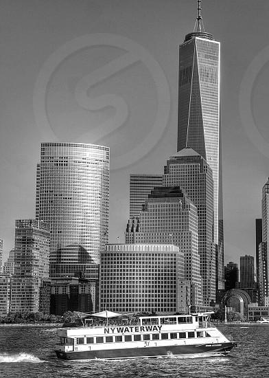 Boat in front of One world trade centerFreedom TowermanhattanNew YorkHudson riverUSAskyscraperarchitecturecitybw photo