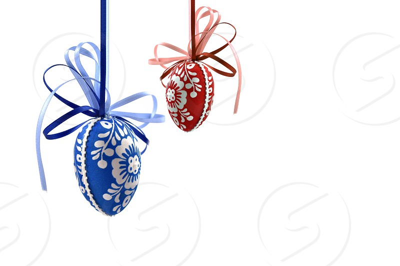 Colorful Easter eggs. Decorated eggs on a white background. Spring decoration images. Hanging Easter eggs. Blue and red easter eggs photo