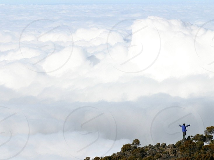 Standing in the clouds Mt Kilimanjaro photo