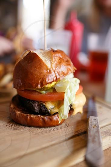 hamburger on brown table photography photo