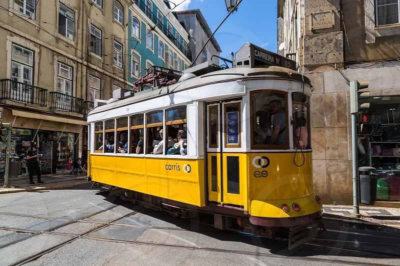 Typical old tram in Lisbon Portugal.  It is a great tourist attraction. photo