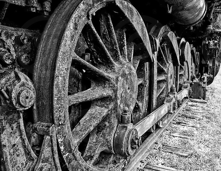 Wheels of old steam locomotive photo