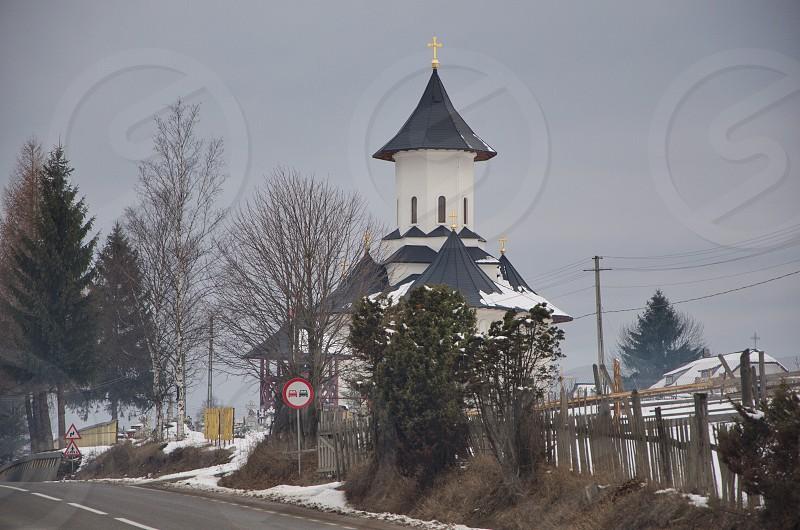 Orthodox church snow coveredsnowwinterBucovinaRomaniaroadtriptourismEastern Europe photo