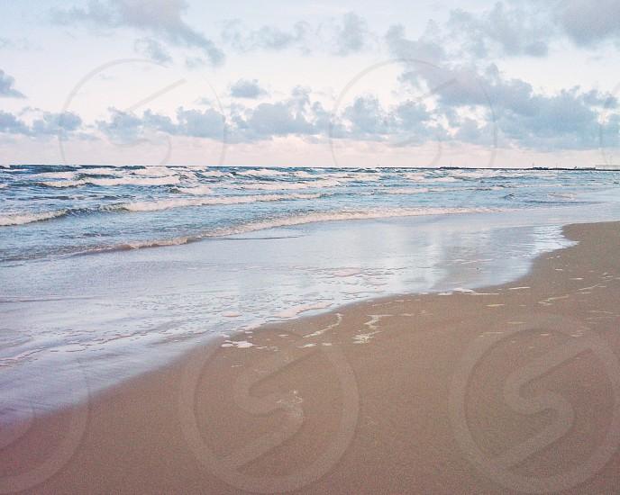 gray sand beach at daytime photo