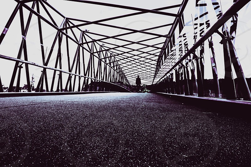 The silhouette of a lady crossing the bridge  photo