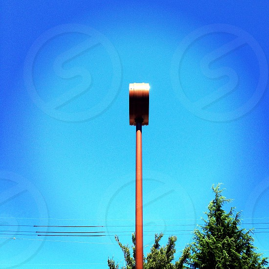 brown streetlight under clear sky during daytime photo