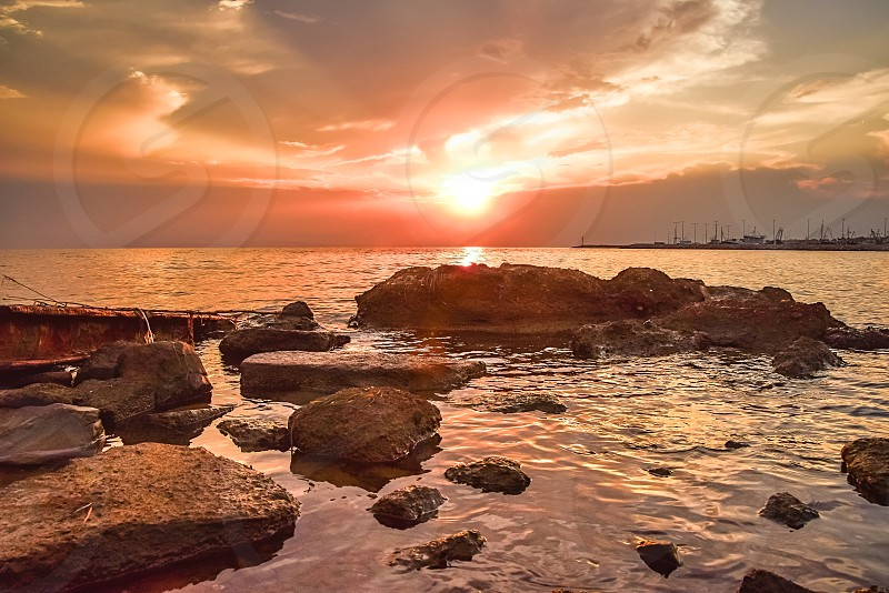 Dramatic Sunset Landscape On The Coast With Sea And Rocks photo