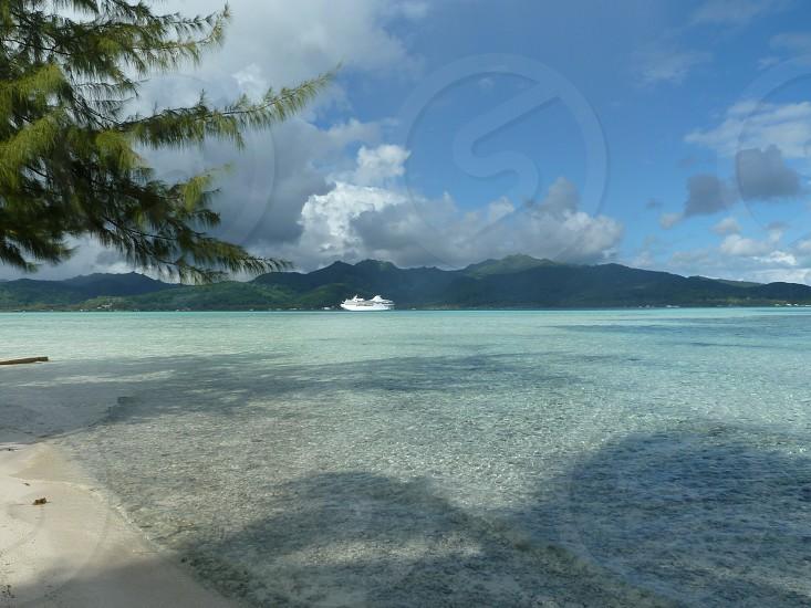 Cruise ship in distance Tahiti blue water photo