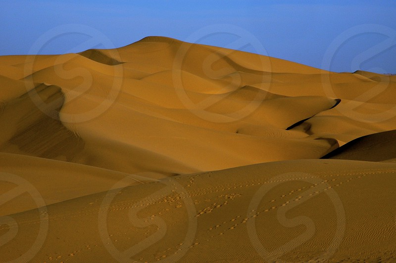 Sand dunes California blue sky drought desert terrain photo