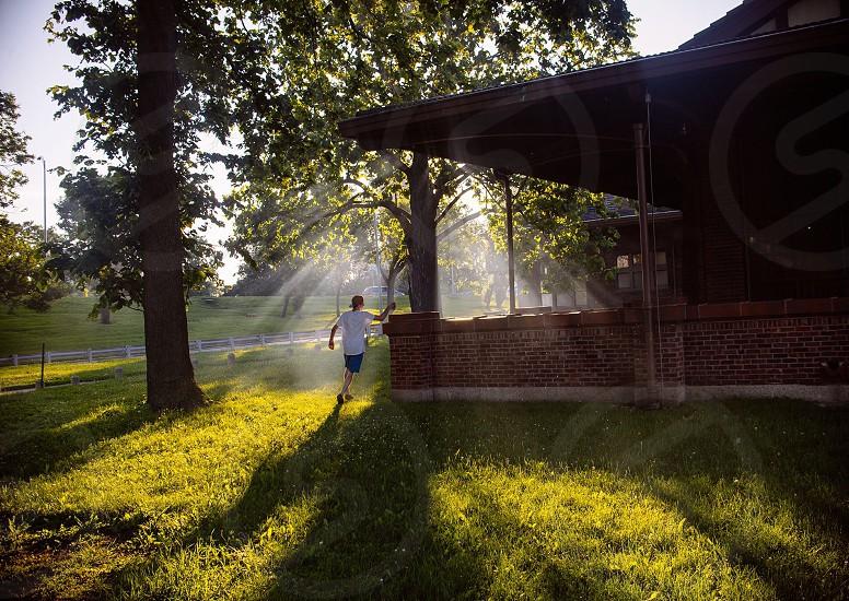 man running beside the house photo