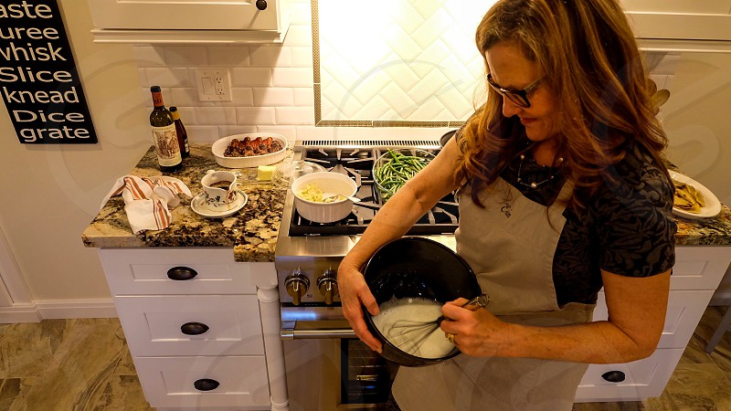 Kitchen  cooking whipping bowl woman whip whisk oven dinner oven stove cooktop  photo