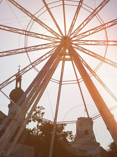 Backlit Ferris Wheel Closeup with Light Leaks in Győr Hungary photo