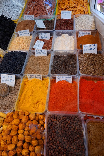 Spices and walnuts on a spice market in Almaty Kazakhstan. photo