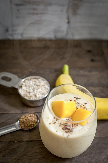 Mango Banana Smoothie with Almond Milk Oats Flax Seeds Chai and Honey photo