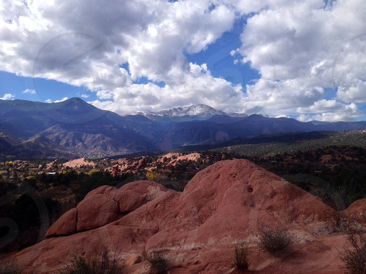 Mountain view red rocks nature sky  clouds Pikes Peak Colorado Garden of the Gods view pretty beautiful photo