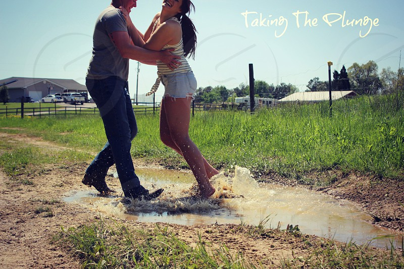 country engagement couple puddle taking the plunge photo