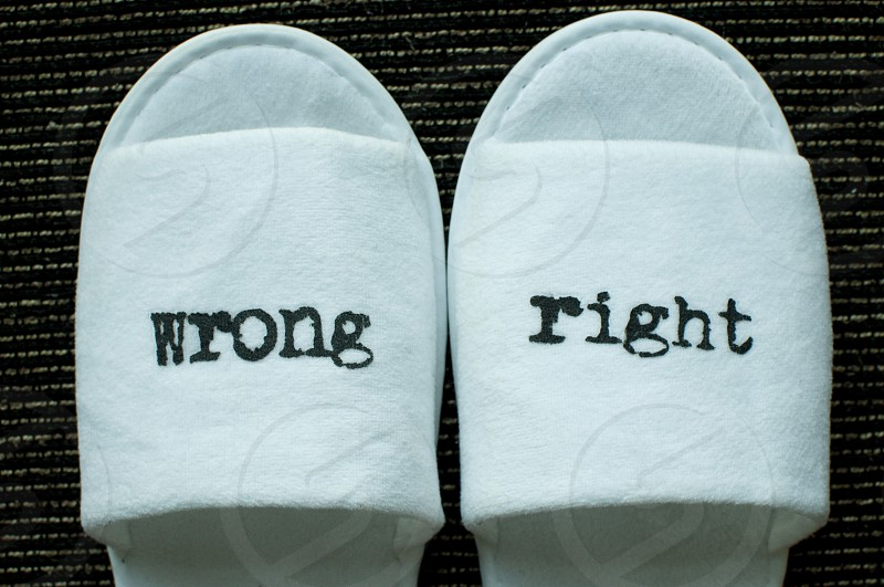 Right and wrong written on slippers photo