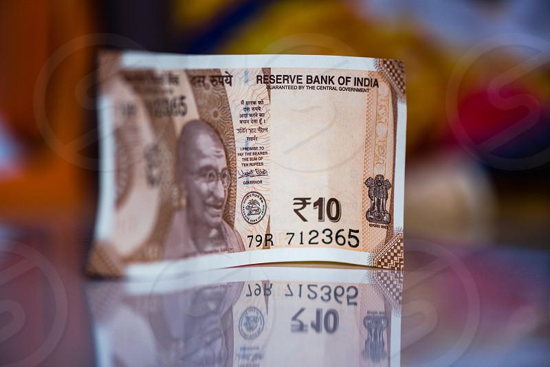 Indian currency notes of Rupees ten on reflective background photo