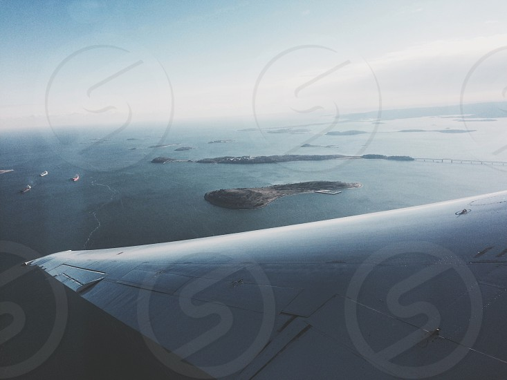 aerial photo of islands near large body of water photo