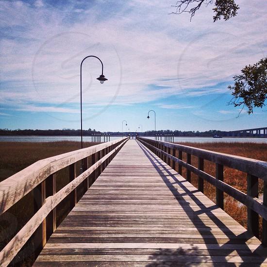 brown wooden lighted footbridge  photo