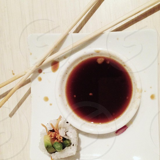soy sauce on ceramic plate photo