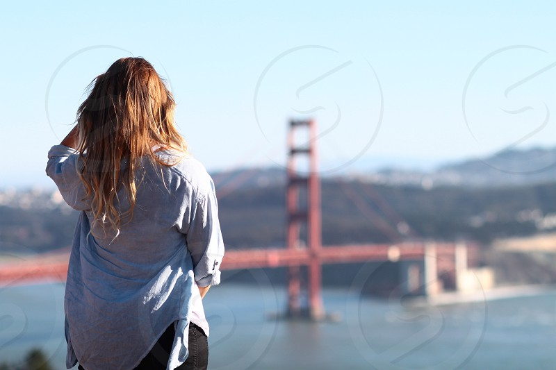 Girl look at Golden Gate Bridge.  photo