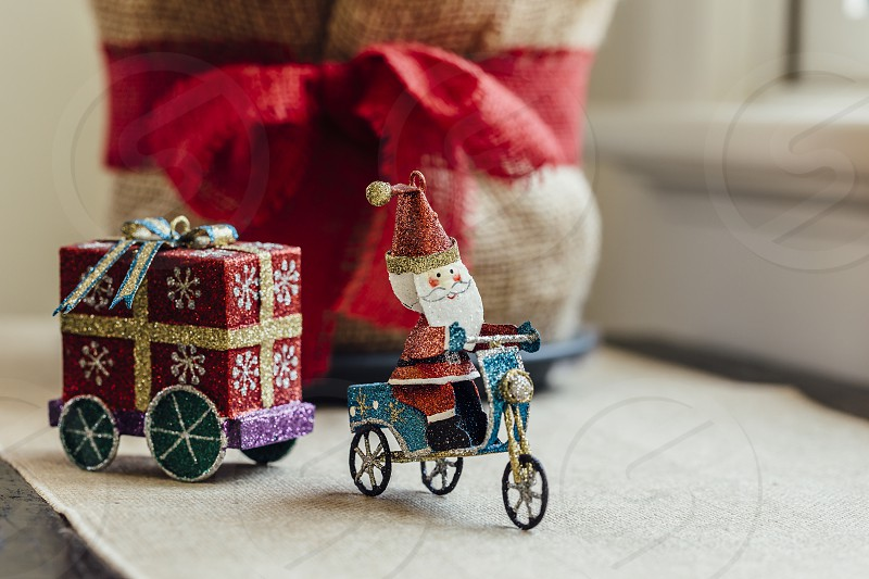christmas ornaments decorations toy santa santa claus father christmas tricycle red green white close-up close up holidays photo