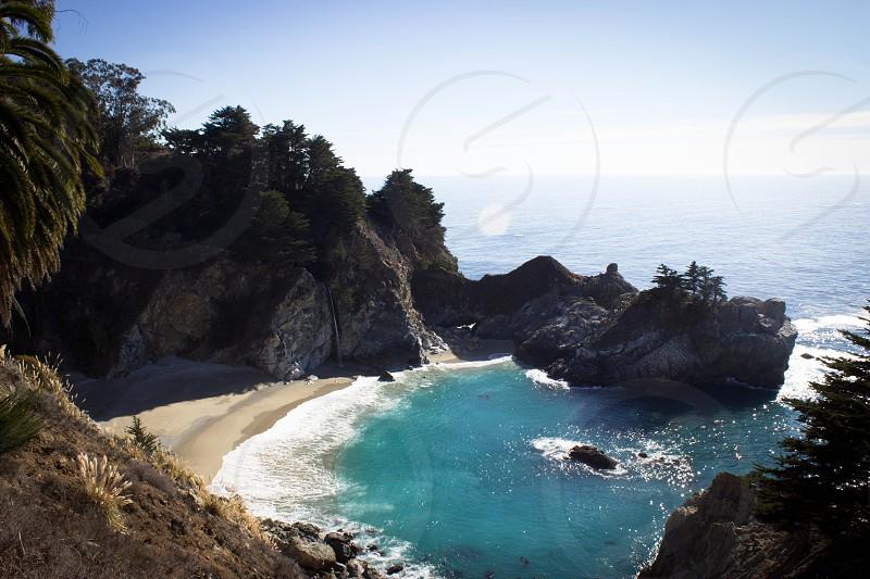 McWay falls Big Sur California waterfall beach paradise beautiful water ocean sand. photo