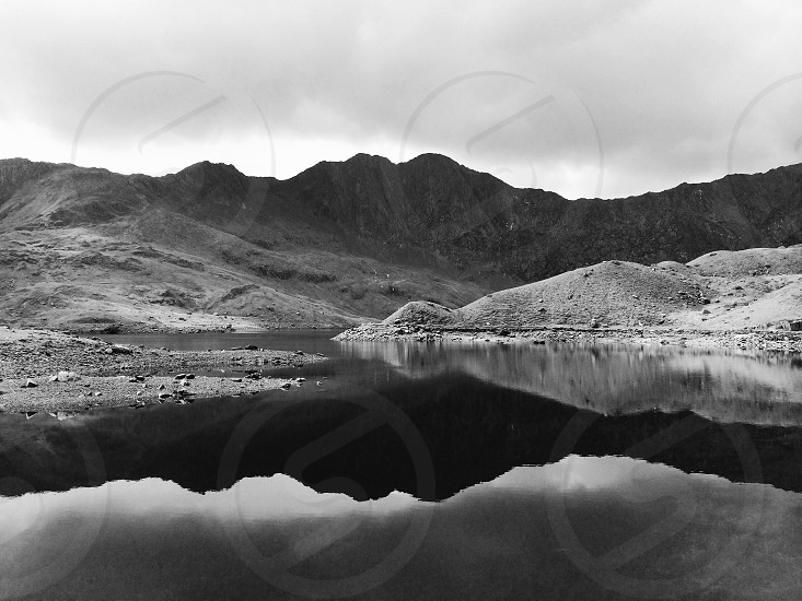 mountain and lake in grayscale photography photo