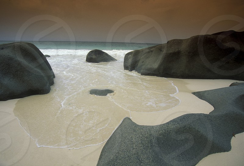 a Beach on the coast if the Island La Digue of the seychelles islands in the indian ocean photo
