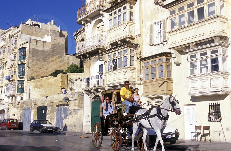 The traditional Balconys on the Houses in the Old Town of the city of Valletta on the Island of Malta in the Mediterranean Sea in Europe. photo